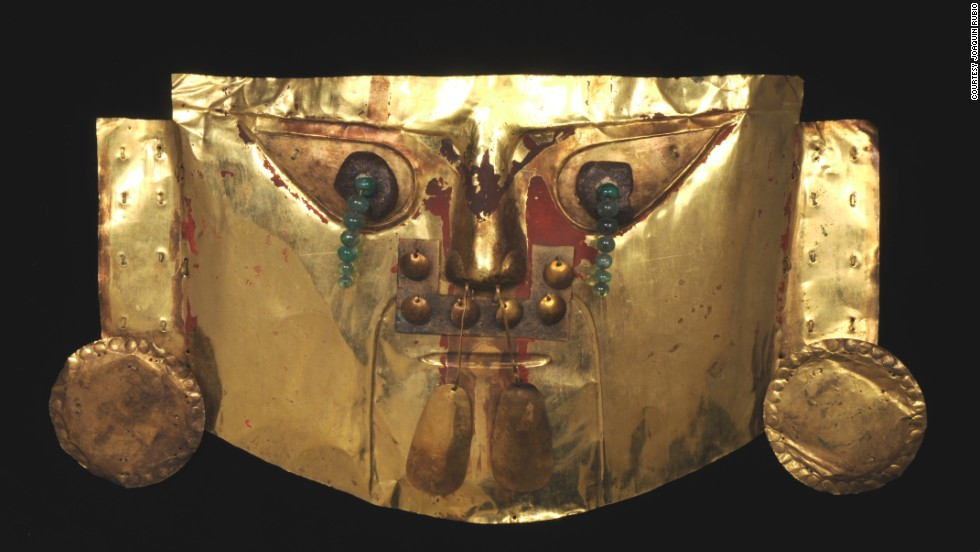 Historically, jewelers set the emeralds in yellow gold, which was thought to be the purest form of metal and the closest thing to Godliness. Emeralds on this funerary mask from Lambayeke, Peru, are meant to represent eyes.