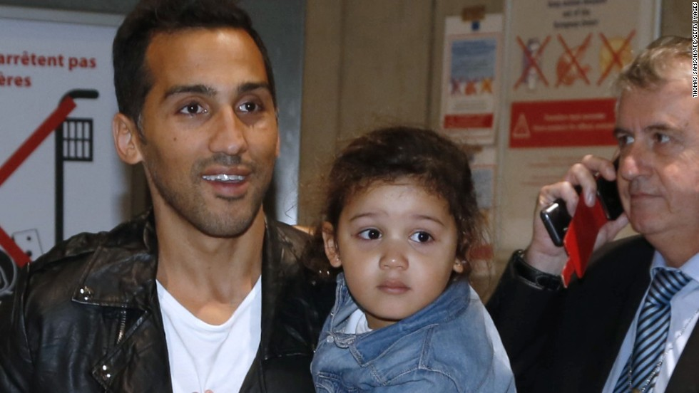 The 33-year-old, here holding one of his two young daughters, had not been able to leave Qatar after he filed a complaint against his club Al-Jaish over a payment dispute.