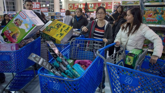 Shoppers hunt for bargains November 28 at Toys R Us in Fairfax, Virginia.