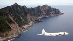 China sails into disputed waters, prompting protest by Japan