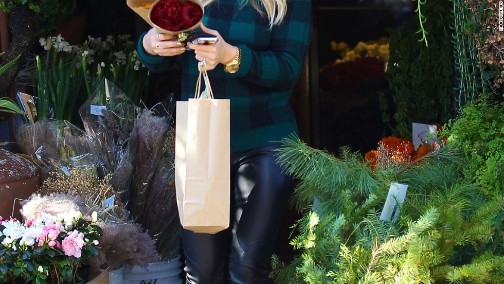 Hilary Duff takes time to smell (and buy) the flowers on November 28.