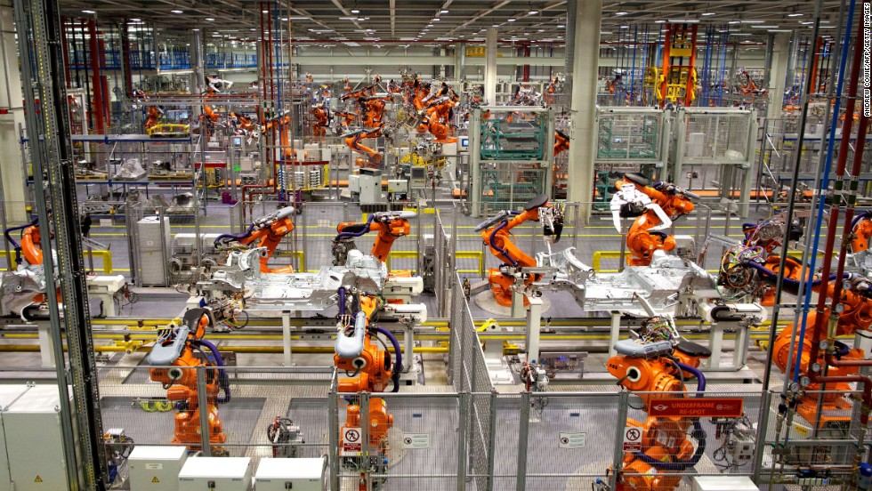 Robots are already being used to produce cars, like those pictured here waiting to build the new Mini Cooper. Robots will increasingly be used for household chores