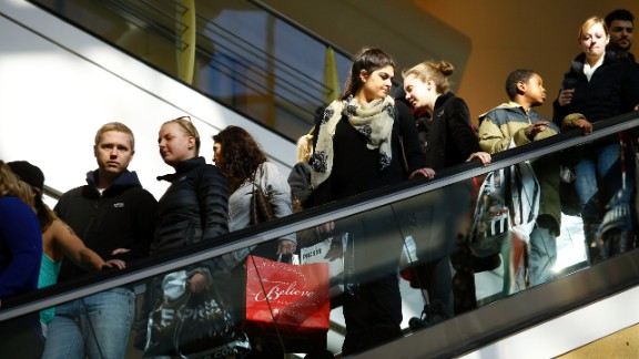 Shoppers crowd onto an escalator at the Somerset Collection mall in Troy, Michigan, on November 29.