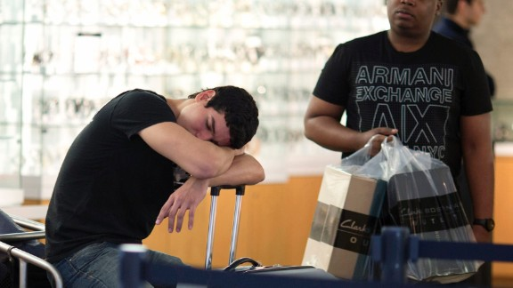 A shopper takes a break at Miami's Dolphin Mall on November 29.