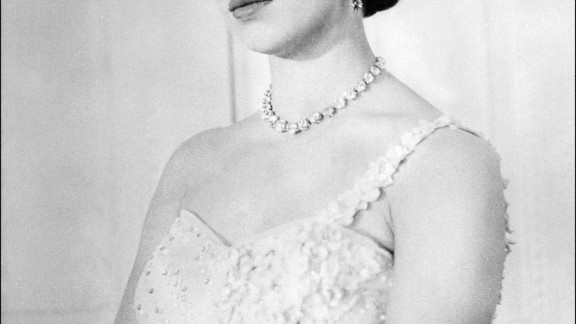 """Princess Margaret was known as a great beauty of her time, and a London """"it"""" girl in the 1950s. She had greater freedom to follow fashion than her sister Queen Elizabeth II, who needed to dress for diplomacy and champion British designers. Here she is pictured on her 26th birthday."""