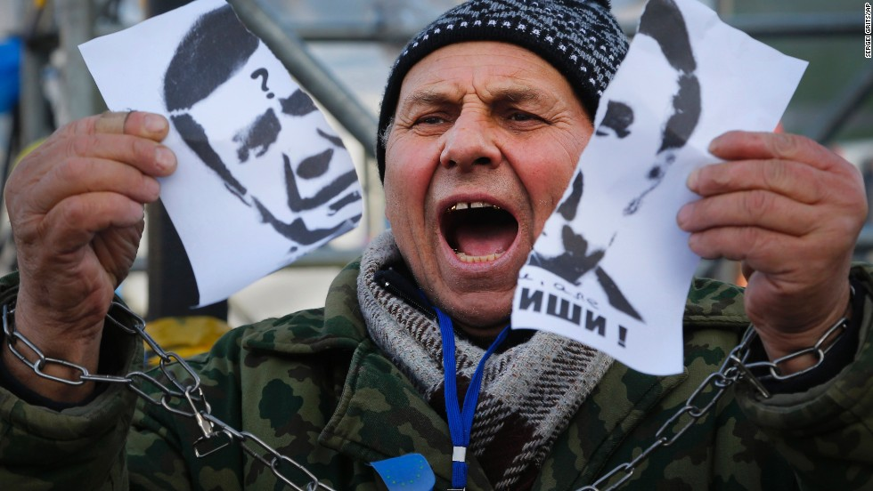 A demonstrator holds a torn portrait of Yanukovych on November 29.