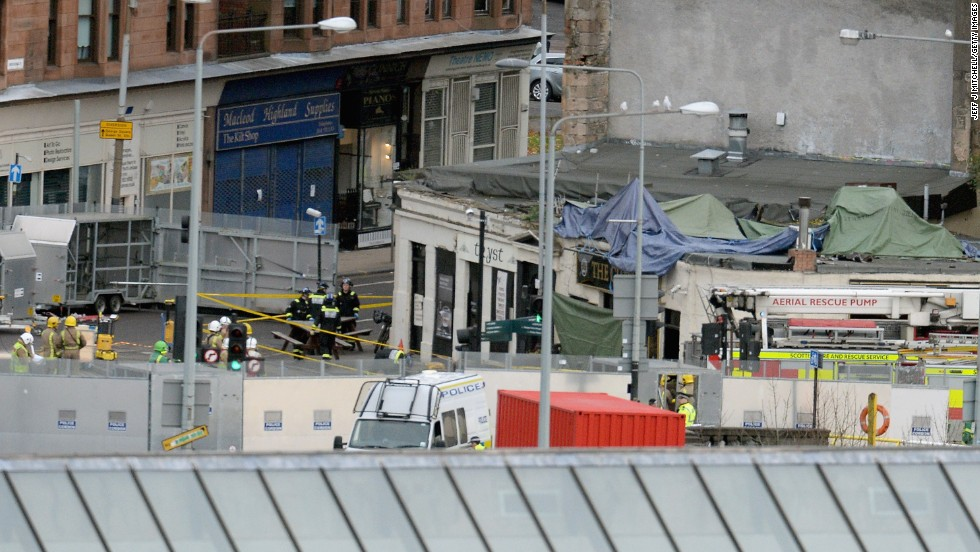Rescue workers in Glasgow, Scotland, tend to the scene Saturday, November 30, where a police helicopter crashed into the Clutha Bar.