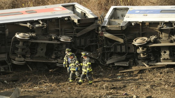 Emergency workers at the scene of a commuter train wreck on Dec 1, 2013 in the Bronx borough of New York. The train bound for New York's Grand Central Station derailed in the Bronx Sunday with at least four people reported dead after several rail cars left the tracks near the Spuyten Duyvil railroad station. The southbound train was traveling from Poughkeepsie to Grand Central Terminal when the accident occurred. AFP PHOTO / TIMOTHY CLARY        (Photo credit should read TIMOTHY CLARY/AFP/Getty Images)