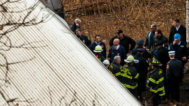 NEW YORK, NY - DECEMBER 1:  New York Gov. Andrew M. Cuomo (3L) inspects the damage along with emergency crews after Metro-North train derailed near the Spuyten Duyvil station December 1, 2013 in the Bronx borough of New York City. Multiple injuries and several deaths were reported after the seven car train left the tracks as it was heading to Grand Central Terminal along the Hudson River line.  (Photo by Christopher Gregory/Getty Images)