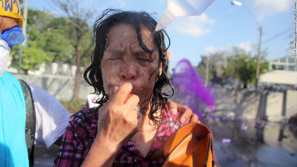 Protesters wash a woman's eyes December 1 after tear gas had been fired in the streets.