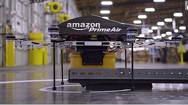This Amazon video shows a drone picking up a package at a warehouse.
