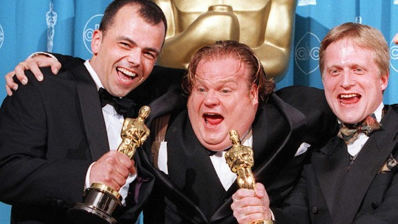 "Chris Farley, at center with filmmakers Tyron Montgomery, left, and Thomas Stellmach after they won the Oscar for best animated short film for ""Quest"" in 1997. Farley was working on the animated film ""Shrek"" when he died of an overdose in 1997. His ""SNL"" colleague Mike Myers took over the role. Here"