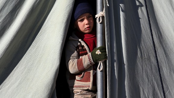 A Syrian child looks out from his tent at a refugee camp in Arsal on Friday, November 29.