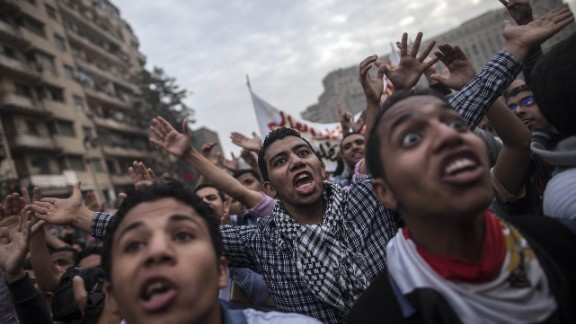 Students backing Mohamed Morsi shout slogans during a demonstration on December 1, in Cairo.