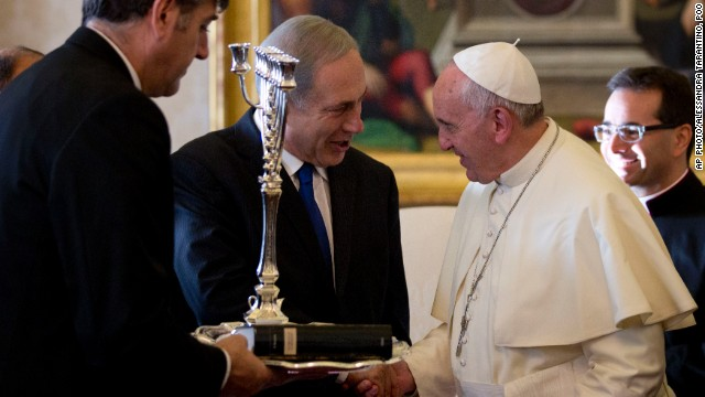 Israeli PM Benjamin Netanyahu presents Pope Francis with a Menorah during their meeting at the Vatican, Monday, December 2.
