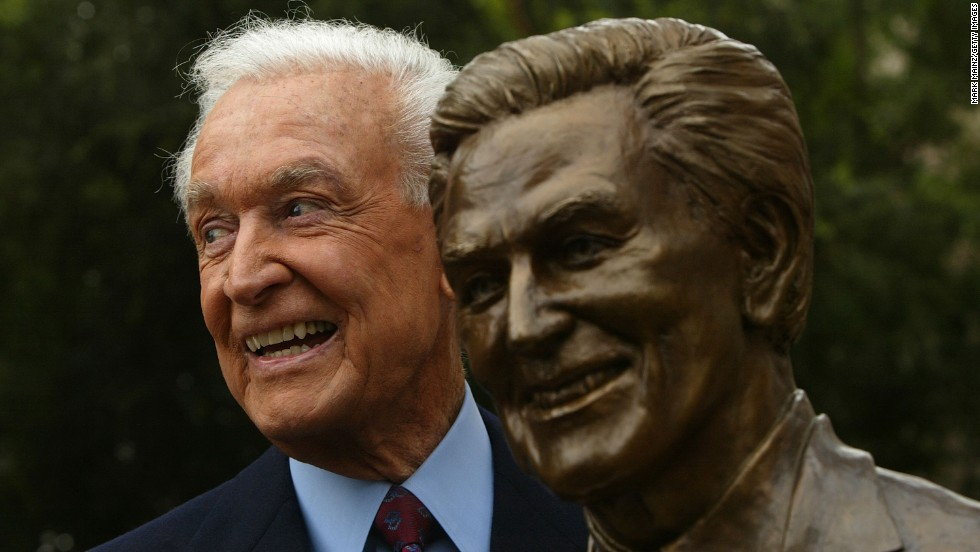 Barker poses next to a sculpture of himself during his induction into the Academy of Television Arts & Sciences Hall of Fame in 2004.