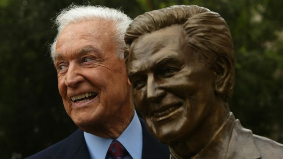 Barker poses next to a sculpture of himself as he was inducted into the Television Academy Hall of Fame in 2004.