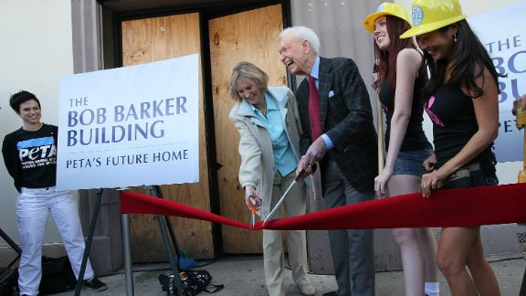 """Barker and Ingrid Newkirk, president of People for the Ethical Treatment of Animals, cut the ribbon at the dedication ceremony of PETA's Los Angeles office in 2010. The office was named """"The Bob Barker Building."""" Barker donated $2.5 million to PETA to purchase and renovate it."""