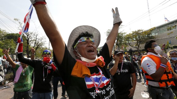 Protesters celebrate on December 3 after news that the government backed down.