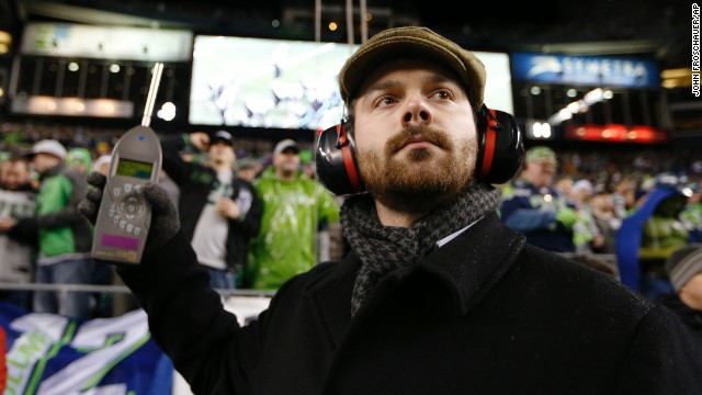 Matt Roe, an acoustical consultant with SSA Acoustics, measures noise levels in CenturyLink Field.