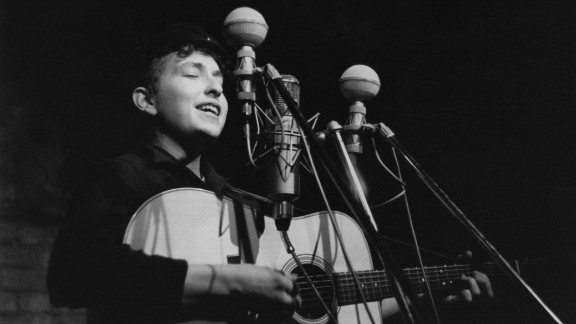 """Dylan performs in 1961 at The Bitter End club in New York City. His first album, """"Bob Dylan,"""" debuted in 1962 and consisted mostly of old folk songs."""