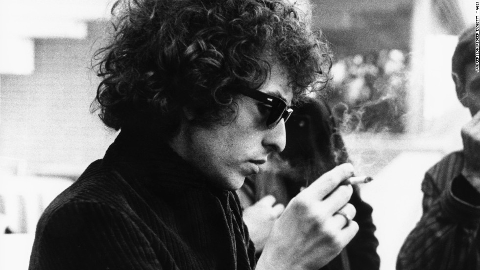 "Bob Dylan smokes a cigarette circa 1966. Dylan's music spoke to a generation of people during the 1960s, a tumultuous decade that forever changed America. He went on to become a rock 'n' roll legend and influence many musicians to come. In October 2016, the Nobel Prize in Literature was awarded to Dylan for ""having created new poetic expressions within the great American song tradition."""