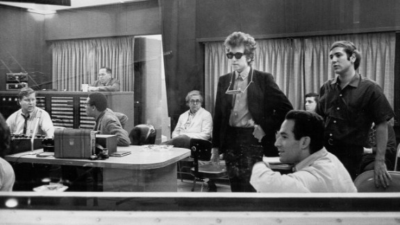 """Dylan listens to recordings of his album """"Highway 61 Revisited"""" in 1965. It contained """"Like a Rolling Stone,"""" which went to No. 2 on U.S. charts."""
