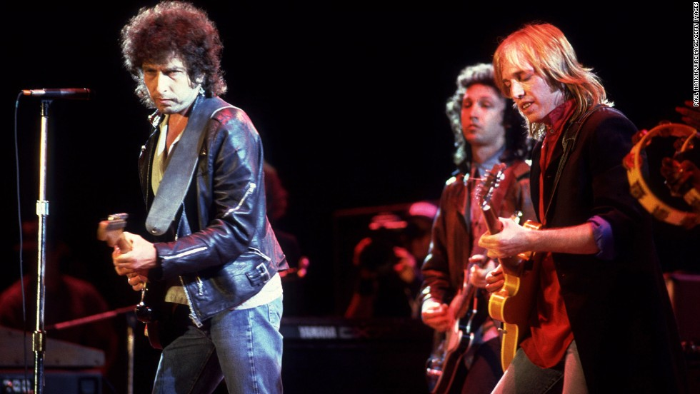 Dylan performs with Tom Petty at Farm Aid in Chicago in 1985.