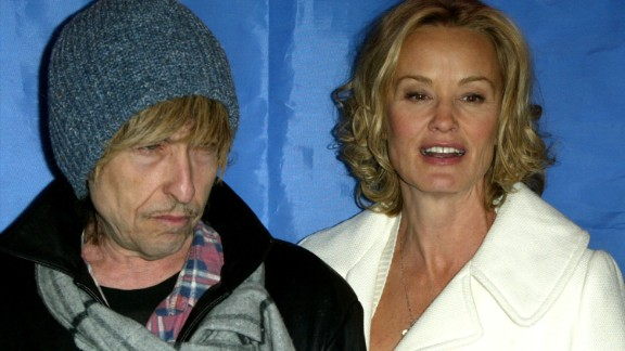 """Dylan appears with actress Jessica Lange during a news conference for the movie """"Masked and Anonymous"""" in 2003. Dylan co-wrote the movie and starred in it."""