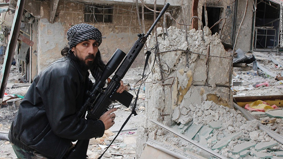 A rebel fighter from the Free Syrian Army holds a position at a front line in the Salah al-Din neighbourhood of the northern Syrian city of Aleppo, on December 1, 2013. The stricken nation dropped nine points from 144th place to 168th in the index.