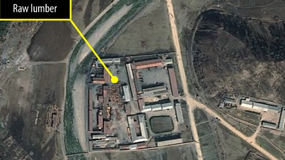 One of four satellite images taken of a probable furniture factory.  Lumber piles changed over time, indicating production activity.