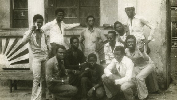 """Allen (middle left) and other musicians with some of the """"area boys"""" at Kalakuta in 1976,"""