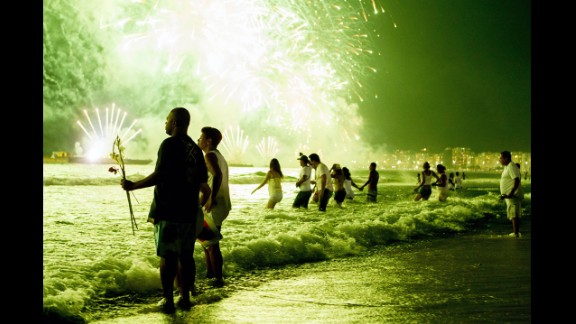 January 1: People watch New Year's fireworks along Copacabana Beach in Rio de Janeiro, Brazil. Photographers worldwide captured deadly conflicts, devastating storms and other memorable moments throughout the year. Click through the gallery to see 2013 unfold from beginning to end.