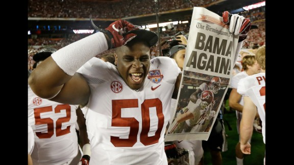 January 7: Alabama defensive lineman Alphonse Taylor holds up a newspaper after Alabama defeated Notre Dame 42-14 in the BCS National Championship game. It was the second straight national title for the Crimson Tide.