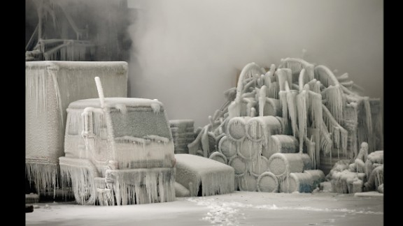 January 23: A truck is covered in ice as firefighters extinguish a massive blaze at a vacant warehouse in Chicago.