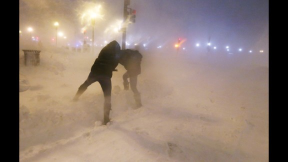 February 8: People shield themselves from snow as a blizzard arrives in the Back Bay neighborhood of Boston.