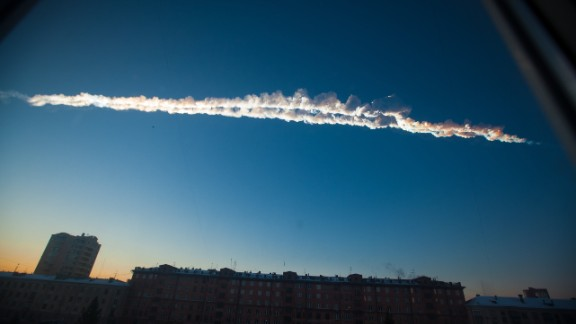 February 15: A meteorite contrail is seen over Chelyabinsk, Russia, about 930 miles east of Moscow. More than 1,500 people were hurt, authorities said, and thousands of buildings were damaged after a meteor exploded in the skies with the force of about 30 early nuclear bombs.