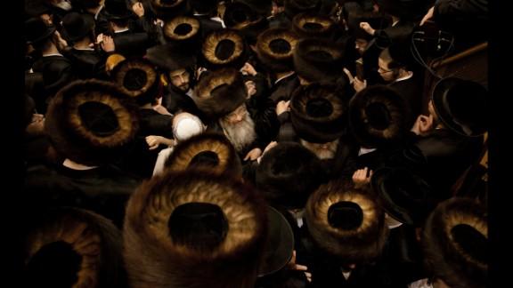 February 25: Ultra-Orthodox Jewish men gather at a yeshiva in Jerusalem during the Purim holiday.