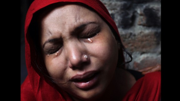 March 10: A Pakistani Christian woman weeps after her home was damaged by an angry Muslim mob during clashes between Christians and Muslims in Lahore, Pakistan.