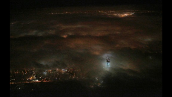 March 11: The One World Trade Center building emerges from the clouds in New York's night sky. Construction on the office complex, which is going up on the site of the original World Trade Center, is set to be completed in early 2014.
