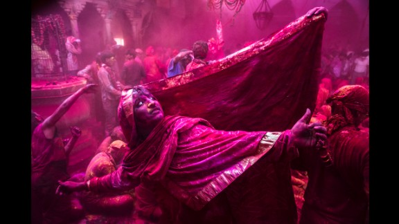 March 21: A transgender Hindu devotee dances during Lathmaar Holi celebrations in the village of Barsana, India.