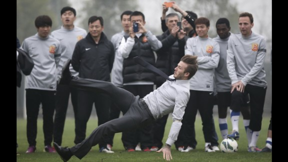 March 23: Soccer star David Beckham falls during a visit with Wuhan Zall, a professional team in Wuhan, China.