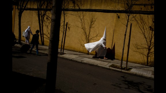March 24: Hooded penitents from the La Paz brotherhood walk to a church in Seville, Spain, to take part in a procession during Easter Holy Week.