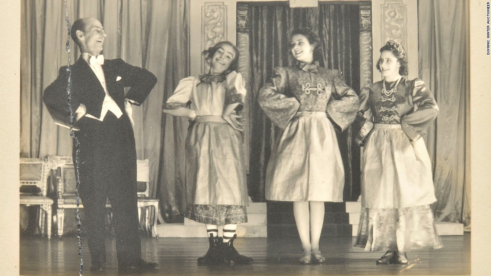 Princess Elizabeth (3R) and Princess Margaret (4R) on stage in a photograph signed in 1943.