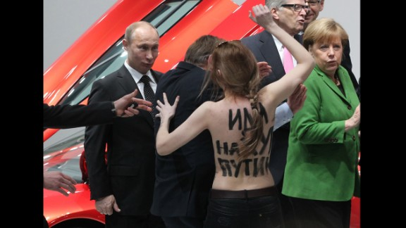 April 8: Russian President Vladimir Putin is attacked by an activist of the Ukrainian women rights group Femen as German Chancellor Angela Merkel looks on in Hannover, Germany.