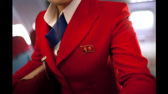 April 11: An Air Koryo attendant wears a pin showing portraits of the late North Korean leaders Kim Il Sung and Kim Jong Il. Air Koryo is the world's only 1-star airline on Skytrax, a consultancy that has ratings and reviews for more than 681 airlines.