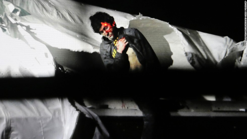 <strong>April 19: </strong>Boston Marathon bombing suspect Dzhokhar Tsarnaev is seen in a boat at the time of his capture in Watertown, Massachusetts.