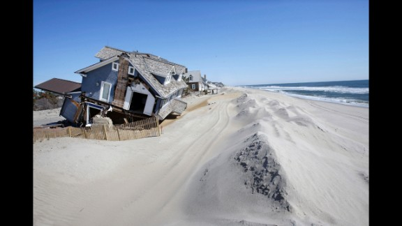 April 25: Homes severely damaged by Hurricane Sandy are seen in Mantoloking, New Jersey, six months after Sandy devastated the Jersey shore and New York City and pounded coastal areas of New England.