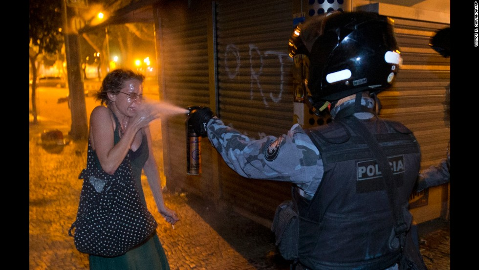 <strong>June 17:</strong> A military police officer pepper-sprays a protester in Rio de Janeiro. Millions of Brazilians took to the streets this summer to protest years of dissatisfaction and discontent with their government.