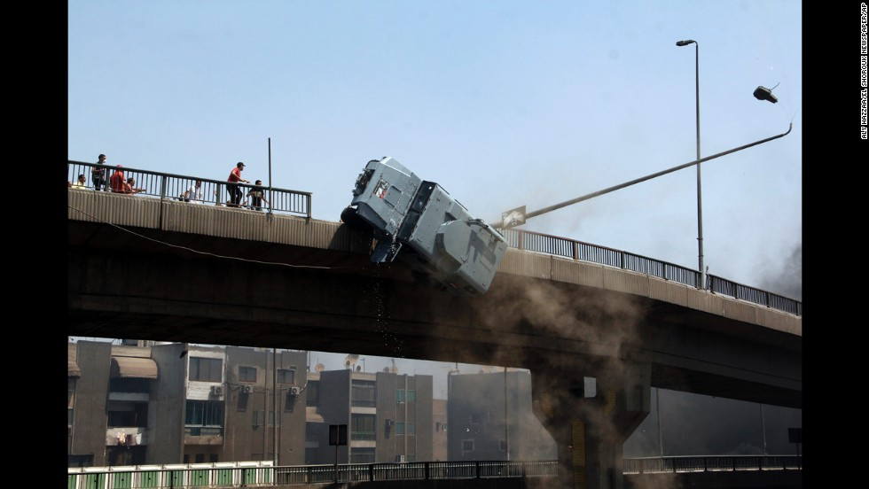 <strong>August 14:</strong> A police vehicle is pushed off the 6th October Bridge in Cairo by supporters of ousted Egyptian President Mohamed Morsy.